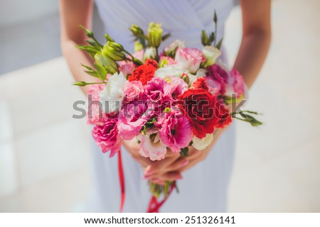 Beautiful wedding bouquet colourfull flowers n hands of the bride lovely day - stock photo