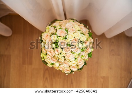beautiful wedding bouquet from beige roses closeup.