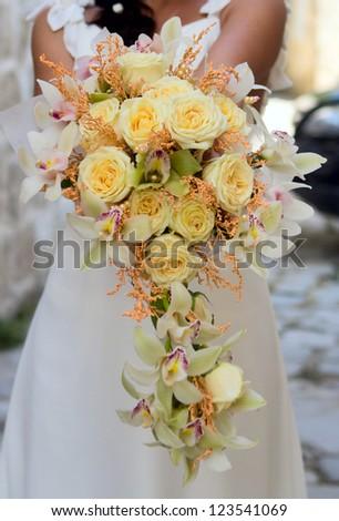 Beautiful wedding bouquet in bride's hand - stock photo