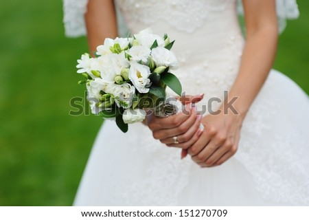 Beautiful wedding bouquet in hand of bride