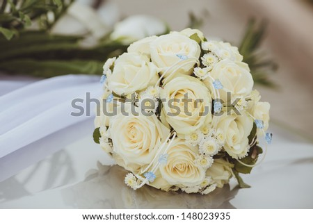 Beautiful wedding bouquet in hands of the bride