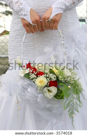 Beautiful wedding bouquet in small basket - stock photo