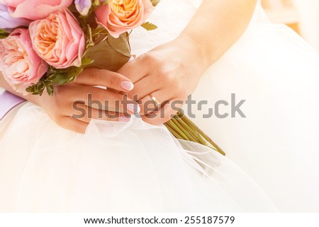 Beautiful wedding bouquet of paeonies in hands of the bride, french manicure - stock photo