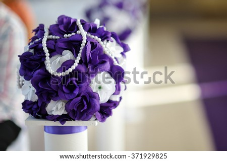 beautiful wedding bouquet of purple and white flowers. - stock photo