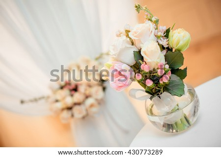 beautiful wedding bouquet of roses in a glass vase on a Deluxe wedding ceremony. bouquet in soft colours