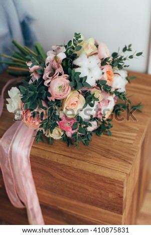 Beautiful wedding bouquet on wooden space. Peony rose, cotton, roses. Pink and Peach. Trendy and modern wedding flowers. Ideal photo for commercial.