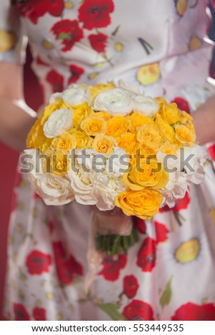 Beautiful wedding bouquet with colorful dress in background