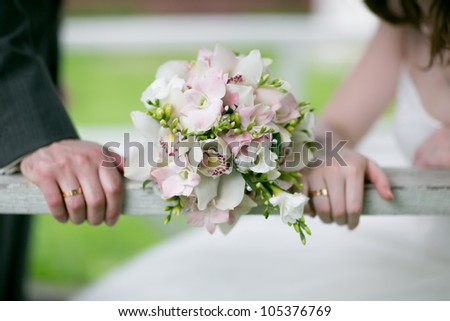 Beautiful wedding bouquet with hands - stock photo