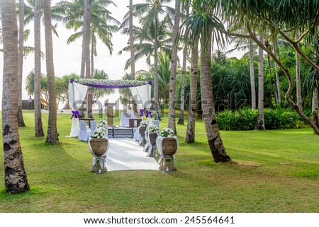 beautiful wedding cabana, arch, outdoor wedding in tropics - stock photo
