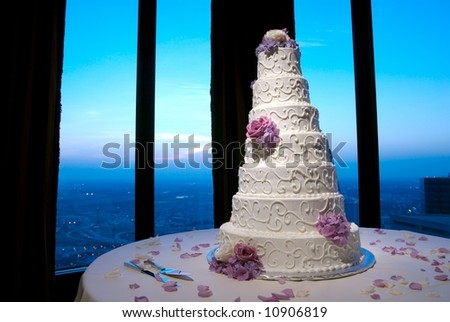 Beautiful wedding cake at a wedding reception looking out over city - stock photo