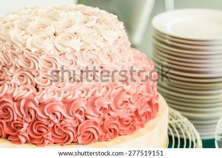 Beautiful wedding cake decorate with flower shaped cream. - stock photo