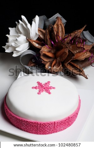 beautiful wedding cake with pink snowflake star
