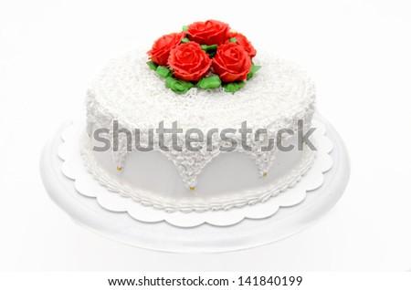 Beautiful Wedding cake with roses isolated over white - stock photo