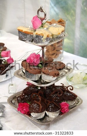 Beautiful wedding cakes and decorations with roses - stock photo