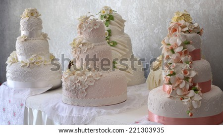 beautiful wedding cakes decorated with flowers - stock photo