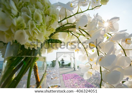 Beautiful wedding ceremony design decoration elements with arch, floral design and  flowers - stock photo