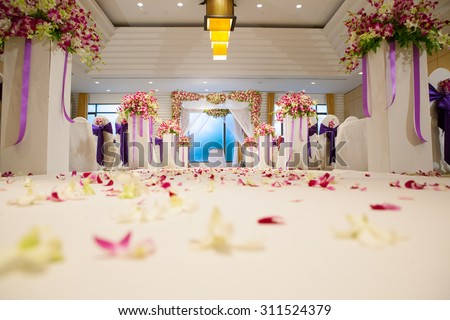 Beautiful wedding ceremony design decoration elements with arch, floral design, flowers, chairs and balloons - stock photo
