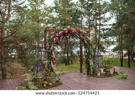 Beautiful Wedding Ceremony Outdoors Decorated Chairs Stand On The Grass Arch Made Flowers