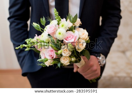 Beautiful wedding colorful nosegay of pink and peach roses - stock photo