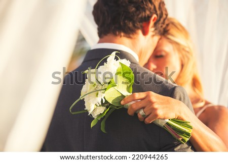 Beautiful Wedding Couple Embracing. Bride and Groom in Love. - stock photo