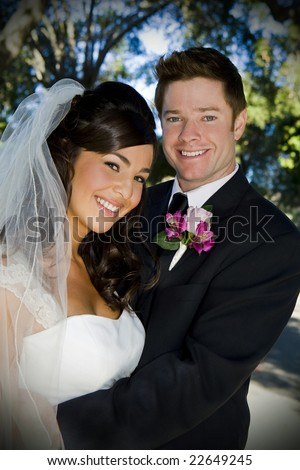 Beautiful wedding couple on their special day - stock photo