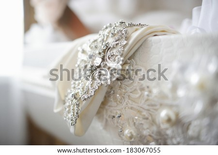 Beautiful wedding dress decoration close up - stock photo