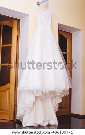 Beautiful Wedding Dress Hanging On Hanger Stock Photo (Royalty Free ...