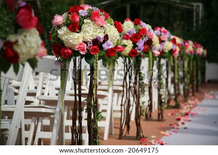 Beautiful wedding flower arrangement of seats along the aisle - stock photo