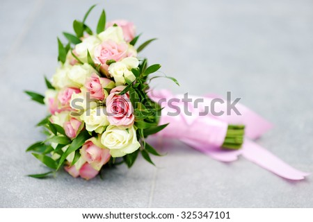 Beautiful wedding flowers bouquet with yellow and pink roses