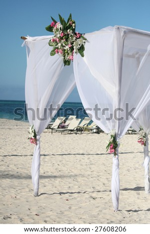 Beautiful wedding gazebo set up for  a beach, ocean front ceremony - stock photo