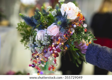 Beautiful wedding or birthday ceremony interior and table decor, flower decoration with flowers bouquet, with roses, tulips, peonies, arch