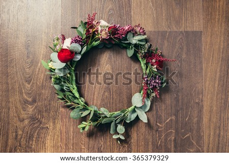 Beautiful wedding red rose flower crown on wooden background