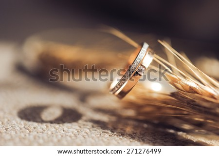 Beautiful wedding ring with diamonds in gold - stock photo