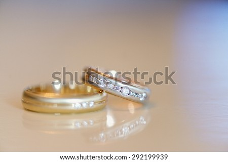 Beautiful wedding rings for bride and groom. Beauty of wedding accessories indoors. Close-up bridal jewellery. Female and male decoration for couple. Jewelry for man and woman. Jewel of marriage - stock photo