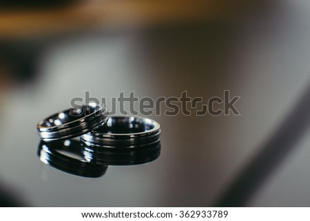 Beautiful wedding rings on glass