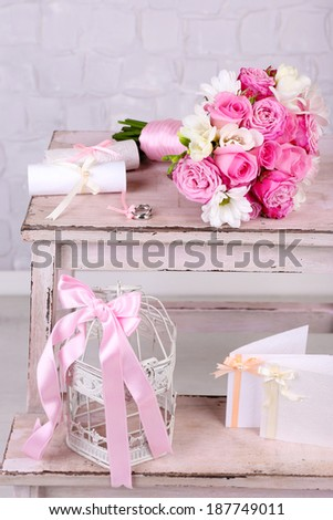 Beautiful wedding still life with bouquet on grey wall background