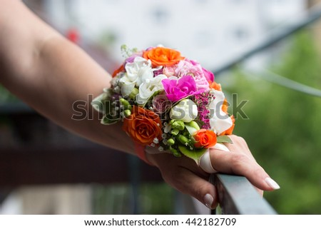 Beautiful wedding wrist bouquet - corsage on a brides hand beautiful fresh floral bracelet for the bride