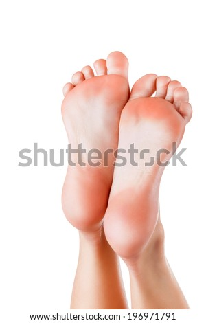 Beautiful well-groomed female a foot and a heel on a white background - stock photo