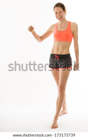 beautiful well trained woman with perfect body is doing some combat sport exercises - stock photo