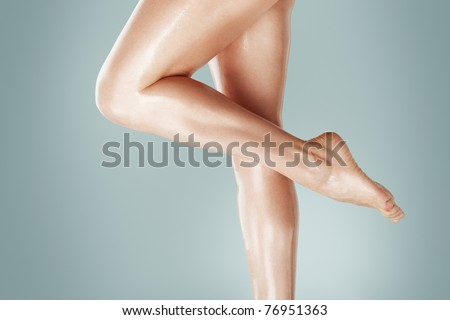 Beautiful wet feet, women legs - stock photo