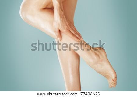 Beautiful wet feet, women legs and hand - stock photo