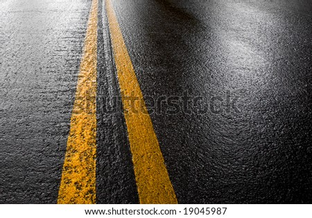 beautiful wet road in the morning light - stock photo