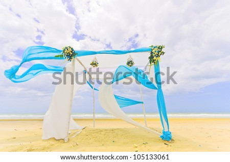 Beautiful white and blue tent on a beach in windy day