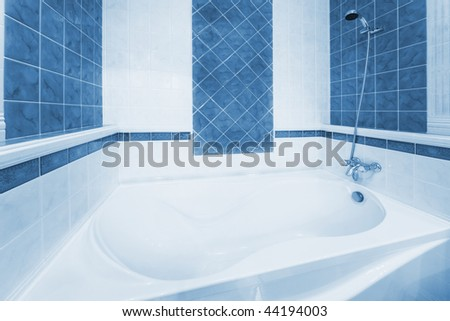 Beautiful, white bath in a modern bathroom - stock photo