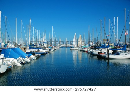 Beautiful white boats and modern yachts at the sea port near San Francisco, California. Luxury lifestyle and wealth concept - stock photo