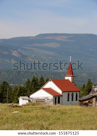 beautiful white church in the mountains - stock photo