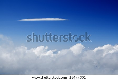 Beautiful white clouds and blue sky on a sunny day , with a long cloud to put your text on - stock photo