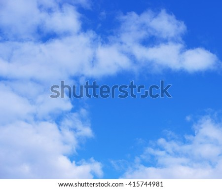 Beautiful white clouds on blue sky background - stock photo