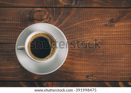 beautiful white coffee Cup with saucer on old vintage wooden background - stock photo