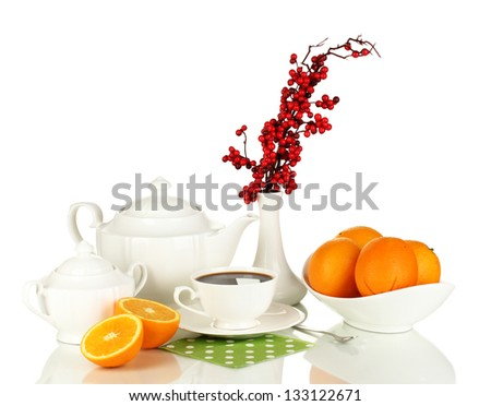 Beautiful white dinner service with oranges isolated on white - stock photo